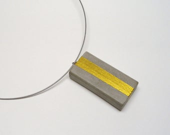 Yellow concrete trailer with stainless steel necklace