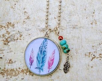 Round pendant. Silver pendant. Vintage feathers. Turquoise. Carnelian. Semi precious. Silver feather.