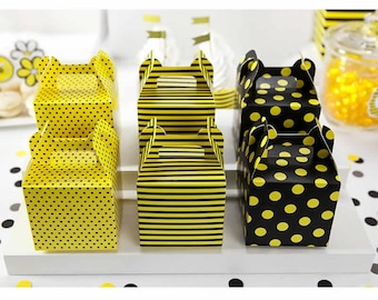 Decorated candies and sweets in yellow and black boxes