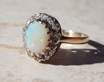 Opal and Diamond Halo Ring 9ct Gold