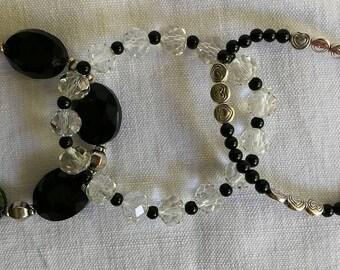3 glass beads and metal bracelets