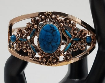 Beautiful Gold Tone Cuff Style Bracelet with Faux Turquoise and Antique Gold Design
