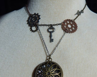 Steampunk necklace with bejeweled cage