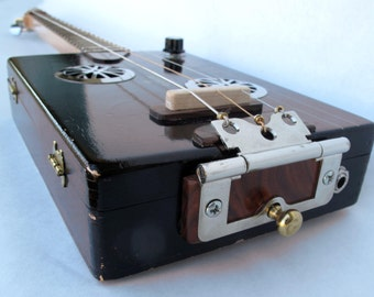 Cigar Box Guitar with pickup for amplifier.