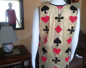 Clubs, Spades, Diamonds or Queen of Hearts. All bring together on this beautiful blouse