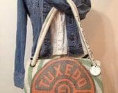 vintage TUXEDO DAIRY feed sack purse - Big Carpetbag