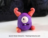 Purple and Orange Horned Monster - Feeping Creatures monster figurine