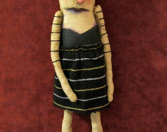 a weird art doll in stripe dress , sandy mastroni, telling secrets weird doll,bizarre ,spooky odd doll