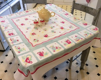 Vintage Broderie Tablecloth Colorful Teapots in the Kitchen