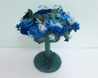 1950s Woman's Pillbox Hat by Danciger with Blue Millinery Flowers, Green Leaves and a Royal Blue Velvet Bow