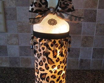 leopard,leopard print,decorated wine bottles,wine bottles with lights,lighted wine bottles,wine bottle lamp,animal print, wine bottle decor