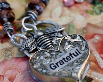 BEE GRATEFUL #2,  hand forged heart, resin and glass glitter filled, sterling wire wrapped.