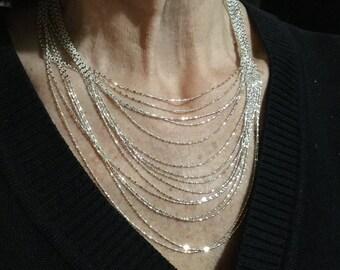Sterling silver multi strand multi length necklace. VJSE