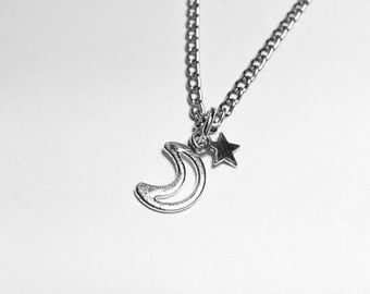 moon and star charm necklace. chain link antiqued silver with a moon charm and a star charm. choose length.