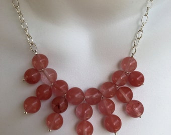 Pink bib style necklace and earring set
