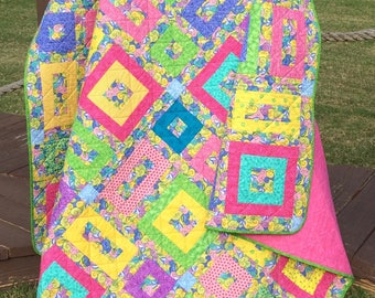 """The Bold Colors Of Spring In Pink, Yellow, Green, Purple, Blue and More Altogether In This 71.5"""" X 71.5"""" Quilt"""