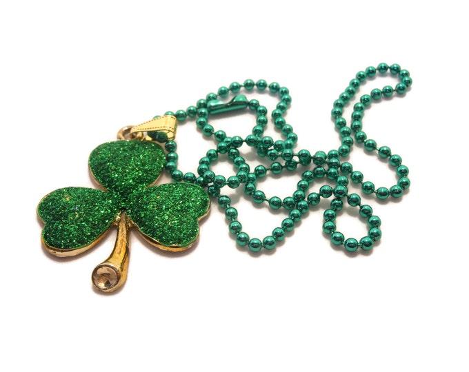 Irish shamrock necklace, green glitter shamrock, gold tone base, green ball chain, three leaf clover