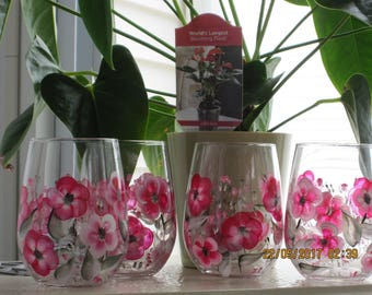 Wine glasses stemless set of four with magenta and white wild flowers green leaves and stems hand painted.