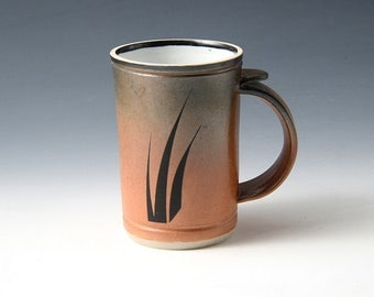 "Demi Mug - Orange Shino ""Three Grass"" design fired into the glaze. Holds 1-1/4 cups • Perfect desktop size."