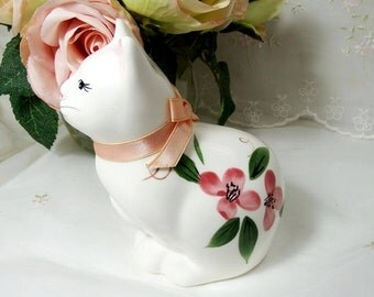 Vintage Porcelain Kitten with a Pink Ribbon and Pink Knockout Roses