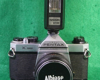 Pentax K1000 with super Albinar 1:2.8 f=28mm len and Nissisin EF30 Flash Free Shipping to SC 29841