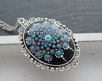 Necklace with mandala cabochon as pendant in turquoise, green & pink in a silver colored cabochon setting