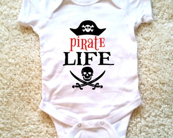 Pirate life graphic baby onesie, available in sizes newborn, 6 months, 12 months, 18 months graphic kid shirt
