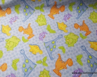 Flannel Fabric - Dinosaurs and Tracks on Blue - 1 yard - 100% Cotton Flannel