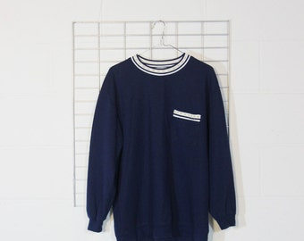 minimal navy blue sweater with a pocket and gold stars