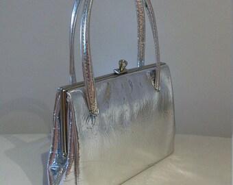 Fab 1960s high gloss silver small handbag- so gogo!