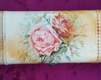 Victorian celluloid glove box with impressionistic roses on cover and palest shell-pink silk lining can be used as a treasure coffer