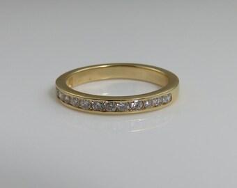 Vintage Diamond Band Ring. Size 4.75  14k Yellow Gold.