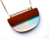 D shaped pendant / necklace handmade from Australian wood and a mixture of pale blue and pale pink resin