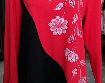 Beautiful handmade shirt decorated with handpainted flower pattern