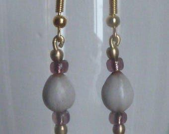 Pendant earrings with lotus seeds