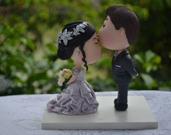 Groom kissing bride. Wedding cake topper. Wedding figurine. Bride and Groom. Handmade. Fully customizable. Unique keepsake
