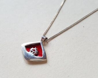 Silver and enamel pendant, 'Sáráhkká', Jokkmokks Tenn, Sweden (F1012)