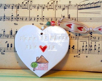 Home is where the heart is Handmade Pottery Heart, hand painted with lovely glazes. Sent to you in a lovely gossamer bag to give as a gift.