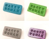 ON SALE - 50% OFF Nasty Woman Pins - handmade with polymer clay. Available in every color. Half of every sale goes to Planned Parenthood