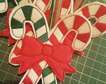 Homemade felt embroidered candy cane christmas tree decoration made with love within the UK.
