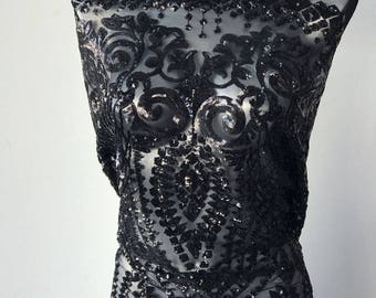 black sequins on black tulle Baroque design latest fashion trend in evening wear