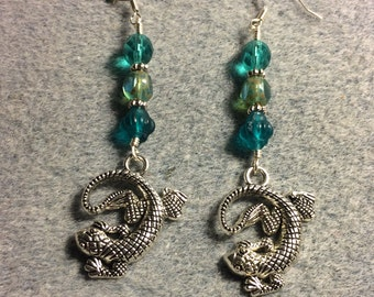 Large silver lizard charm dangle earrings adorned with large turquoise Czech glass beads.