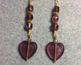 Transparent violet Czech glass heart bead dangle earrings adorned with violet Czech glass beads.