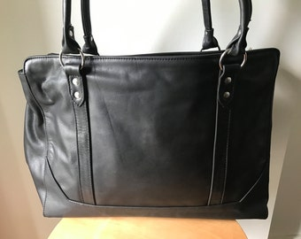 Work and computer tote bag.Strong straps, fully lined traditional tan leather tote bag.Real leather with divider for computer. Leather tote