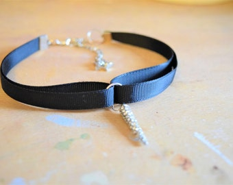 Black ribbon choker.