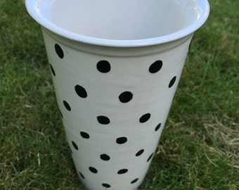 Ceramic travel mug hand decorated with polka dots (black and white)