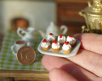 Miniature cake on the plate. Sweets . Miniature food. Miniature in a dollhouse. On the scale of 1/12