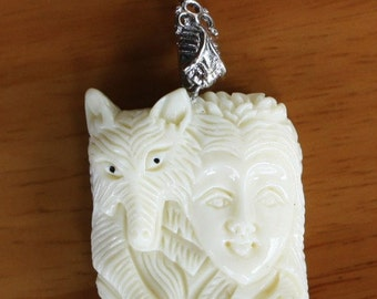 Natural Hand-Carved Bone Pendant Ivory color with bail. 49x31x12 mm.