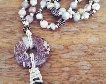 Bohemian statement prayer beads with water buffalo tooth pendant.