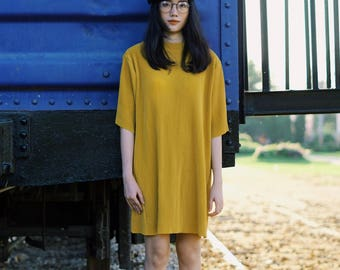 Minimal Mustard Yellow Pleat Oversized Dress with High Neck and Short Sleeve